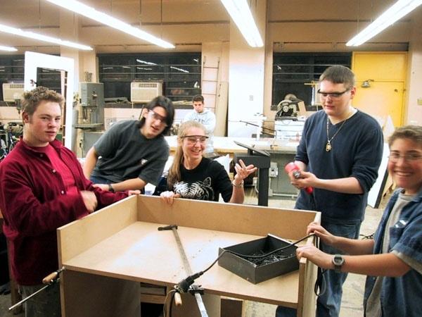 Students building Equip Rack